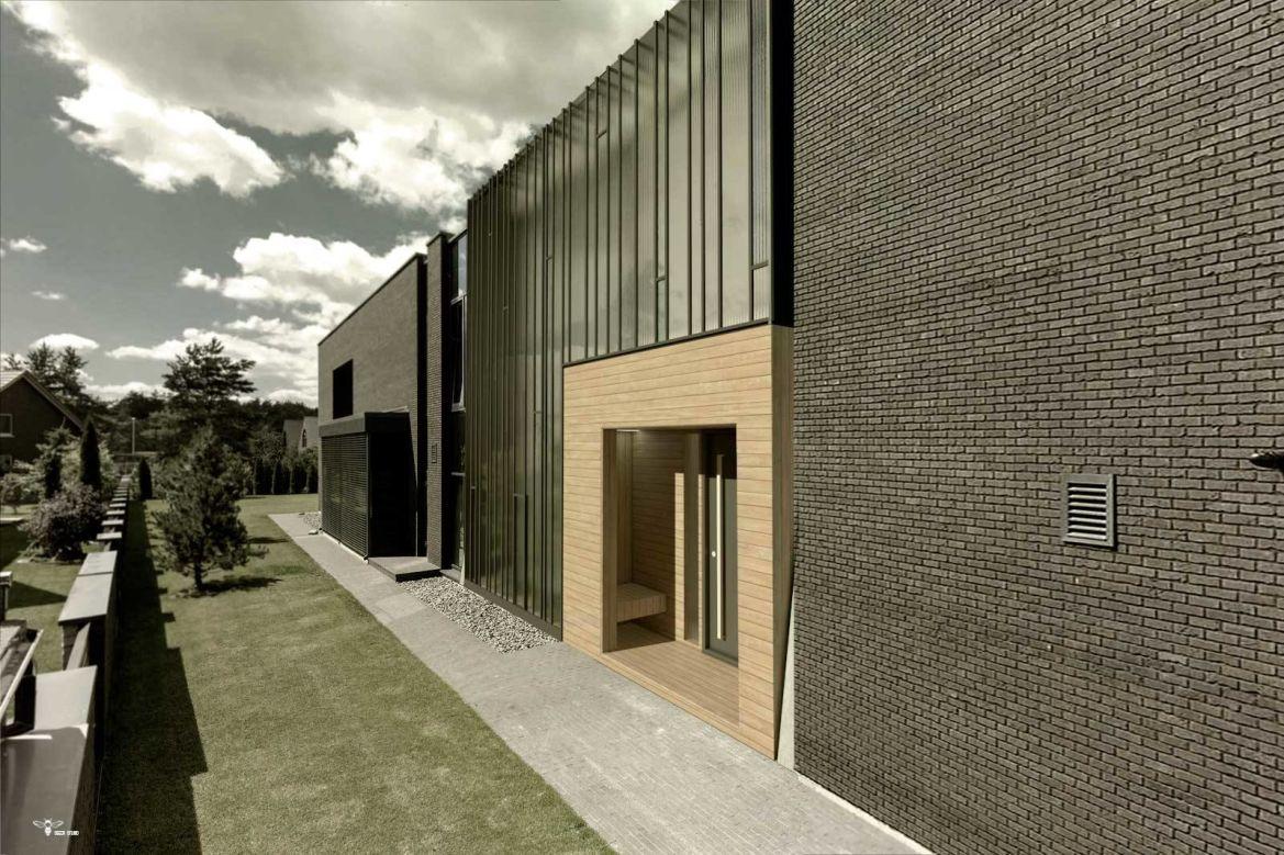 استودیو معماری دیدا طراحی معماری - نمای ساختمان مدرن که متشکل از متریال هایی چون چوب ترموود و شیشه های فیوز گلس با فریم های آهن مشکی